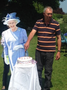 The Parish Chairman cutting the cake for Her Majesty!